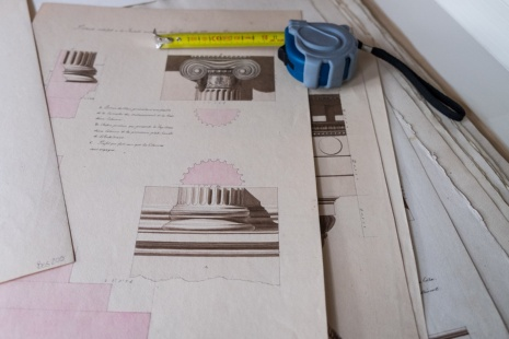 Architectural drawings and tape measure